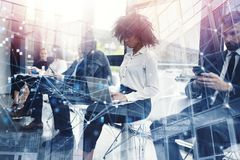 Business people connected on internet network with laptop and tablet. concept of startup company. double exposure stock images
