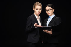 Business people connecting and holding clipboard, business teamwork Stock Photos