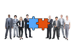 Business People Connecting Jigsaw Puzzle Royalty Free Stock Image