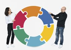 Business people connecting jigsaw puzzle pieces royalty free stock photo