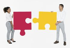 Business people connecting jigsaw puzzle pieces royalty free stock photos