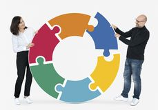 Business people connecting jigsaw puzzle pieces stock photos