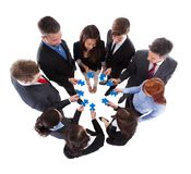 Business people connecting puzzle pieces Royalty Free Stock Image