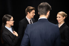 Business people connecting and standing in studio isolated on black Stock Photos