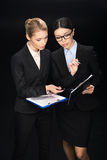 Business people connecting during work and using clipboards, business teamwork. Isolated on black stock images
