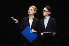 Business people connecting during work and using clipboards, business teamwork. Isolated on black royalty free stock photos