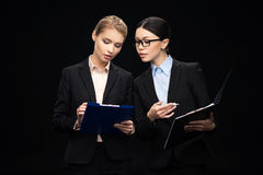 Business people connecting during work and using clipboards, business teamwork. Isolated on black royalty free stock photo