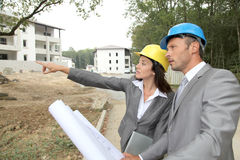 Business people on construction site Royalty Free Stock Image