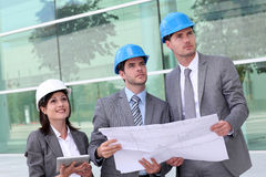 Business people on construction site Stock Images