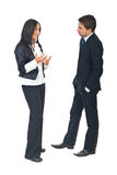 Business people conversation. Full length of two business people having a conversation and woman explaining something to man isolated on white background Royalty Free Stock Photos