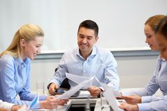 Happy business team with papers at office Stock Photography