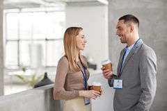 Businesswoman and businessman at coffee break Stock Image