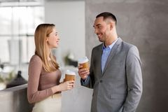 Businesswoman and businessman at coffee break Royalty Free Stock Image