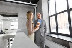 Businesswoman and businessman at coffee break Stock Images
