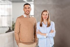 Smiling businesswoman and businessman at office Royalty Free Stock Photos