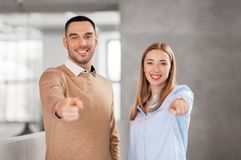 Businesswoman and businessman pointing at you Stock Images