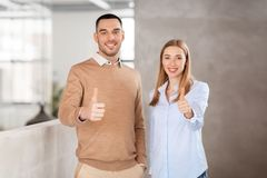Businesswoman and businessman showing thumbs up Royalty Free Stock Photo