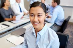Happy smiling young businesswoman at office Stock Photo