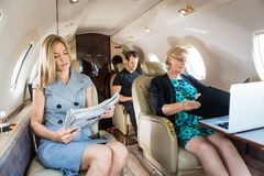Business People In Corporate Jet Royalty Free Stock Image