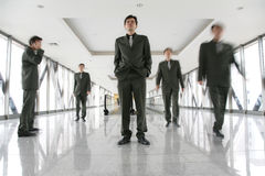 Business people in corridor Royalty Free Stock Photography