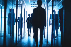 Business people in corridor Royalty Free Stock Images