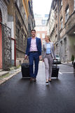 Business people couple entering  hotel Royalty Free Stock Photography
