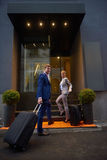 Business people couple entering  hotel Royalty Free Stock Photos