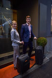 Business people couple entering  hotel Stock Photos