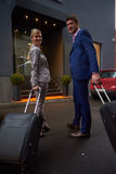 Business people couple entering  hotel Royalty Free Stock Photo