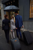 Business people couple entering  hotel Stock Photography