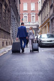 Business people couple entering  hotel Stock Image