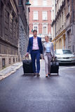 Business people couple entering  hotel Royalty Free Stock Image