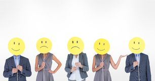 Business people covering faces with various smileys against white background. Digital composite of Business people covering faces with various smileys against Stock Photo