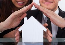 Business People Covering House Model Stock Photos