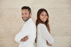 Business people with crossed arms leaning against each other bac Royalty Free Stock Image