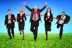 Business people crossing finish line Royalty Free Stock Photography