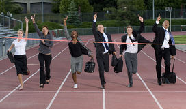 Business People Crossing the Finish Line Royalty Free Stock Images