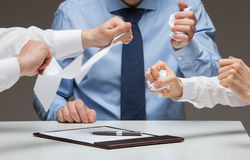 Business people cruelly tearing documents Stock Image