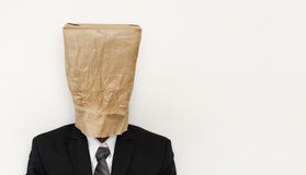 Business people with crumpled brown paper bag on head, with copy space Stock Photo