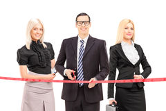 Business people cutting a red tape Stock Photos