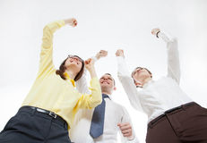 Business people demonstrate a gesture of triuph Stock Image