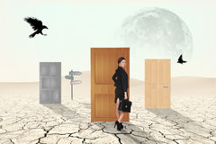 Business people in desert Stock Images