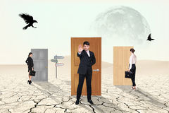 Business people in desert Stock Image
