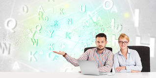 Business people at desk with green word cloud Royalty Free Stock Image