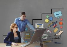Business people at a desk looking at a computer against grey background with graphics. Digital composite of Business people at a desk looking at a computer Royalty Free Stock Images