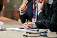 Business people details at conference Stock Photo
