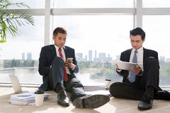 Business people with devices Royalty Free Stock Photo