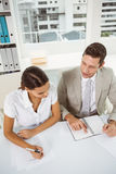 Business people with diary in office Stock Image