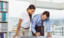 Business people with diary in office Stock Photography