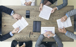 Business people discuss contract Stock Images